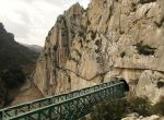 Journalists (C) walk along the new Caminito del Rey (The King's Little Pathway) in El Chorro-Alora, near Malaga, southern Spain March 15, 2015. Dubbed by many media outlets as the world's scariest pathway, the three-kilometre long pathway, which was built at about 100 metres (330 ft) above the gorge of Los Gaitanes between the years of 1901 and 1905, was closed in 2001 after five people died. A new walkway has then been built over the old walkway and will open to the public on March 28, 2015. REUTERS/Jon Nazca (SPAIN - Tags: SOCIETY TRAVEL ENVIRONMENT)