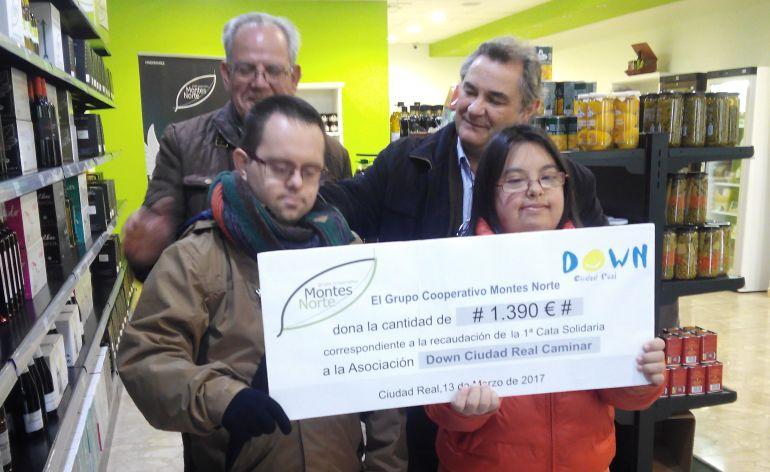 Montes norte dona euros a down caminar ser ciudad for Grupo el norte