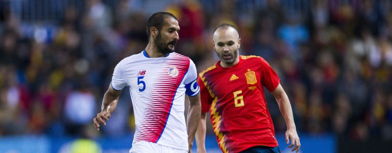 Andres Iniesta of Spain duels for the ball with xCelso Borges of Costa Rica