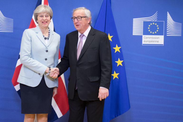 La primera ministra británica, Theresa May, y el president de la CE, Jean-Claude Juncker.