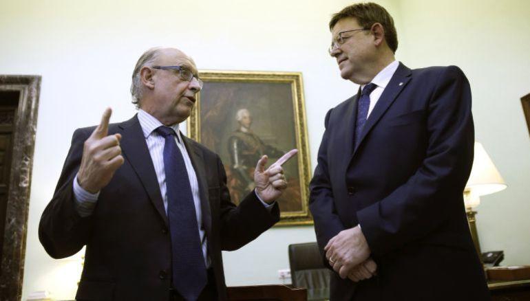 El ministro Cristóbal Montoro con el president XImo Puig