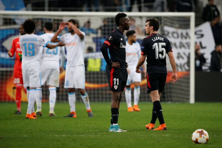 - Europa League Round of 16 First Leg - Olympique de Marseille vs Athletic Bilbao - Orange Velodrome, Marseille, France - March 8, 2018   Athletic Bilbao's Inaki Williams and Inigo Lekue look dejected as Marseille's Luiz Gustavo celebrates after the match