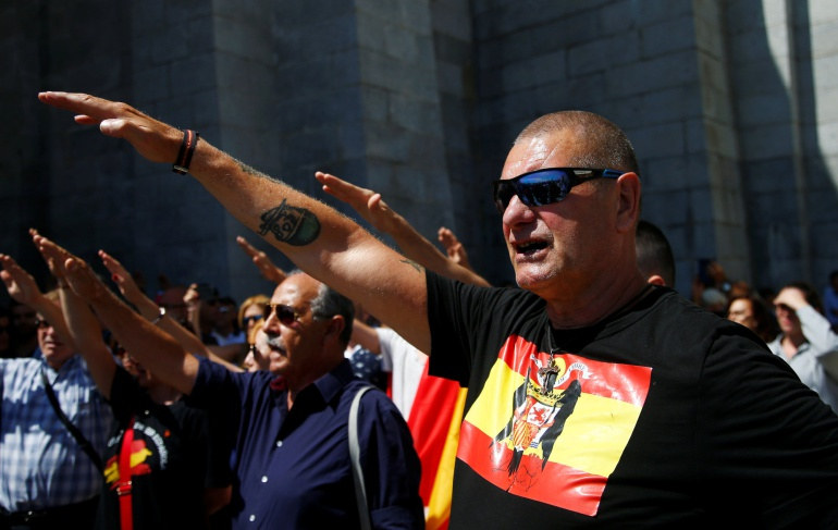 People attend a demonstration against plans by Spain's Socialist government to remove the remains of fascist dictator Francisco Franco from the Valle de los Caidos state-funded mausoleum.