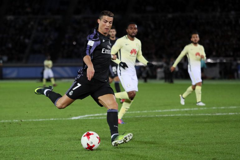 YOKOHAMA, JAPAN - DECEMBER 15:  Cristiano Ronaldo of Real Madrid scores the second goal to make the score 0-2 during the FIFA Club World Cup Semi Final match between Club America and Real Madrid at International Stadium Yokohama on December 15, 2016 in Yokohama, Japan.  (Photo by Matthew Ashton - AMAGetty Images)