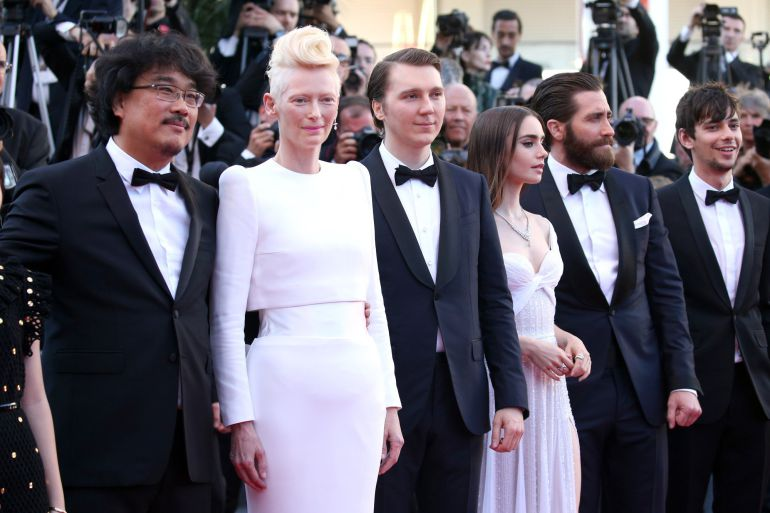 "Director Bong Joon-Ho, Paul Dano, Lily Collins, Jake Gyllenhaal and Steven Yeun attend the ""Okja"" screening during the 70th annual Cannes Film Festival at Palais des Festivals on May 19, 2017 in Cannes, France"