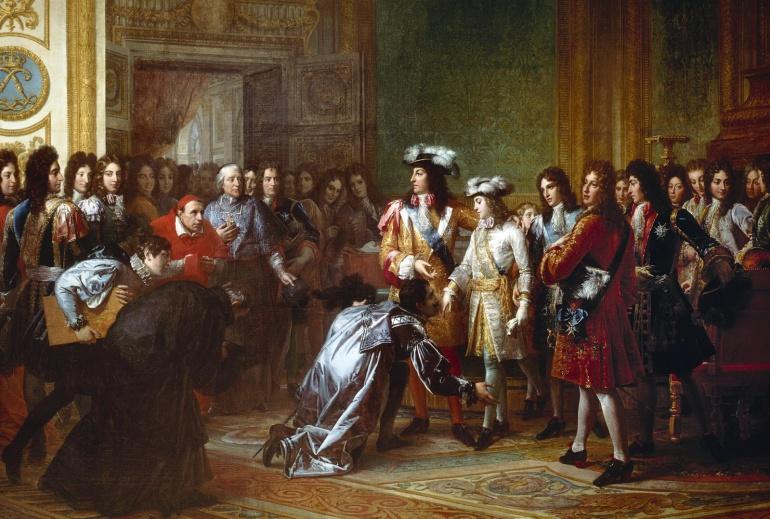 El rey Felipe V, impulsor de la Ley Sálica, en una visita al Palacio de Versalles