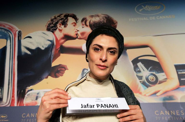 "News conference for the film ""Three Faces"" in competition – Cannes, France May 13, 2018. Cast member Behnaz Jafari holds a card with the name of the director Jafar Panahi during a news conference"