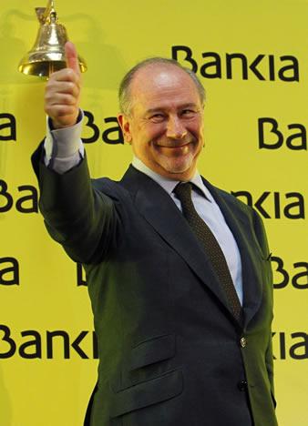El presidente de Bankia, Rodrigo Rato, tras dar el tradicional toque de campana en el inicio de la negociación en Bolsa de las acciones del grupo