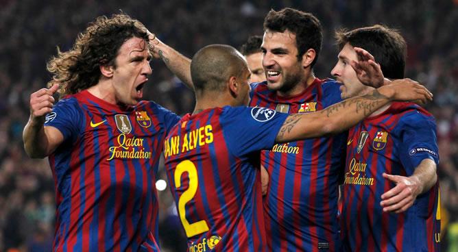 Puyol, Alves, Messi y Cesc celebran el segundo gol del argentino ante el Milan