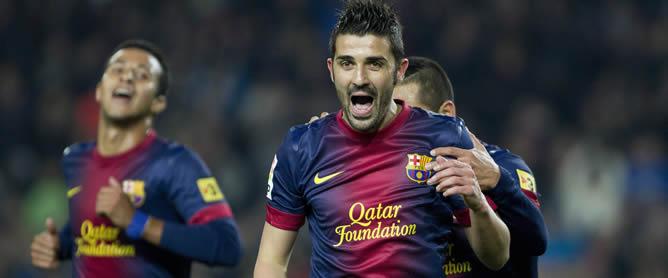 El delantero del Barcelona David Villa celebra su segundo gol, el tercero de su equipo en el partido ante el Córdoba, correspondiente al encuentro de vuelta de octavos de final de la Copa del Rey, disputado esta noche en el Camp Nou