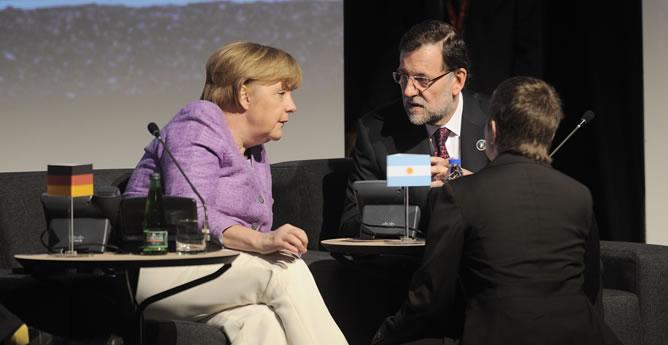 El presidente del Gobierno, Mariano Rajoy junto con la canciller alemana, Angela Merkel, en la cumbre de Chile.