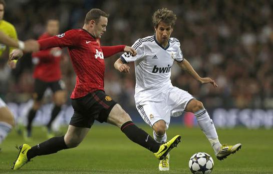 FOTOGALERIA: Coentrao y Rooney disputan un balón