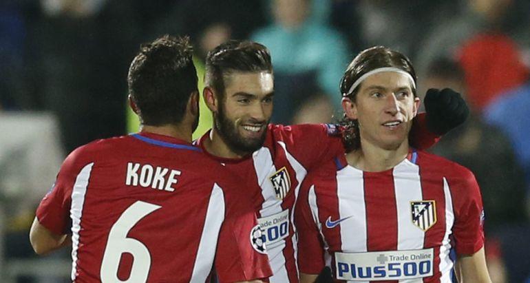 Carrasco celebra su gol junto a Koke y Filipe