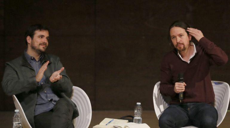 El secretario general de Podemos, Pablo Iglesias Y Alberto Garzón, coordinador federal de Izquierda Unida