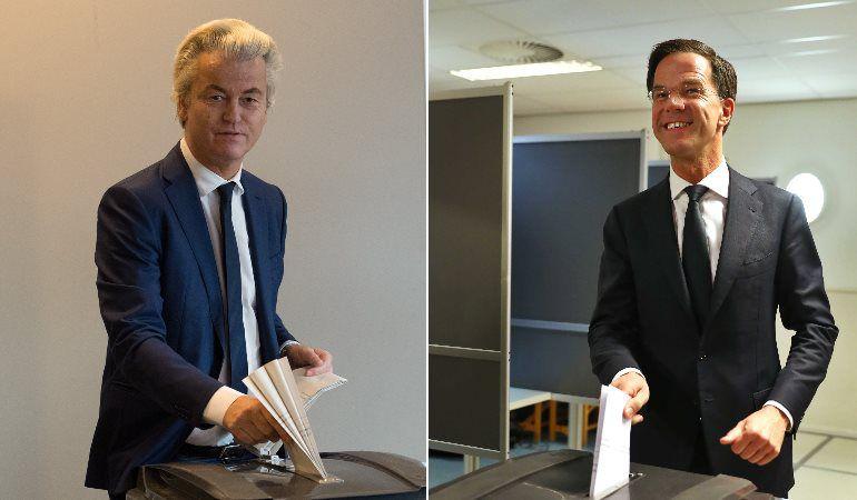 El líder ultraderechista y el primer ministro de Países Bajos, Geert Wilders y Mark Rutte, respectivamente, depositan su voto en La Haya.