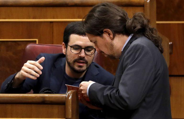 El líder de Podemos, Pablo Iglesias, y el coordinador general de Izquierda Unida, Alberto Garzón.