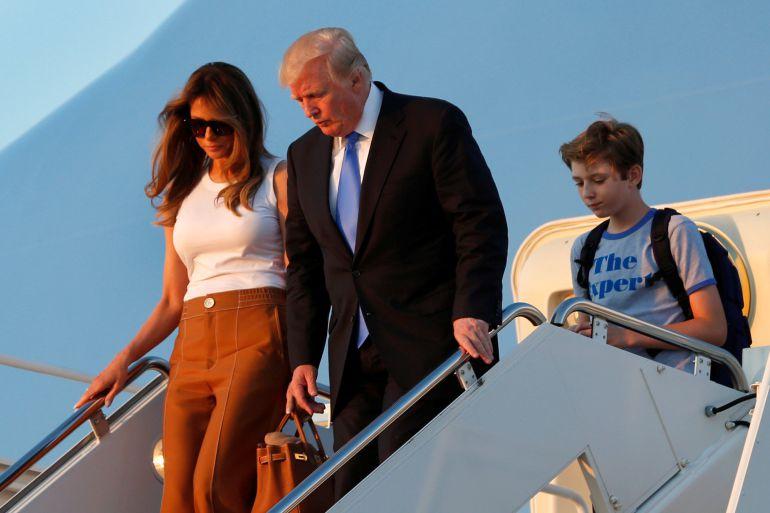 Donald Trump con Melania y el hijo de ambos, Barron.