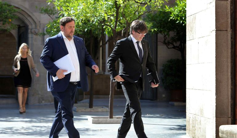 El presidente de la Generalitat, Carles Puigdemont y el vicepresidente, Oriol Junqueras