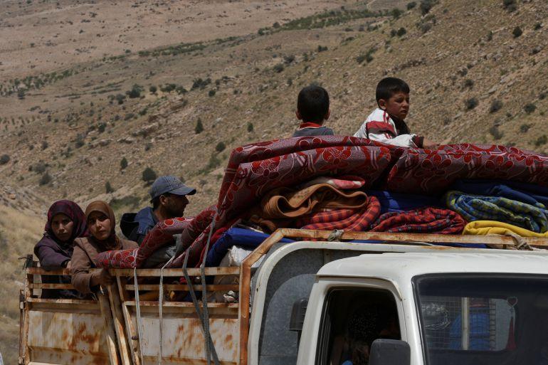 Refugiados sirios en su camino a Líbano