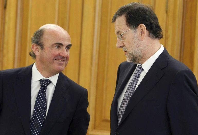 Luis de Guindos y Mariano Rajoy.