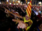 People raise their arms during celebrations in Sant Jaume square after the Catalan regional parliament declared independence from Spain in Barcelona, Spain, October 27, 2017. REUTERS/Yves Herman