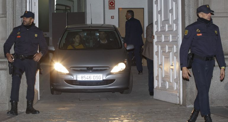 A police car takes Catalan regional parliament speaker Carme Forcadell to prison