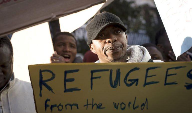 Imagen de archivo de marzo de 2017 de la concentración frente al Ministerio de Asuntos Exteriores en Madrid para exigir la acogida de refugiados.