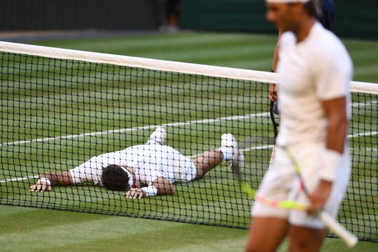 Del Potro y Nadal, en un instante del épico partido que han protagonizado en Wimbledon.