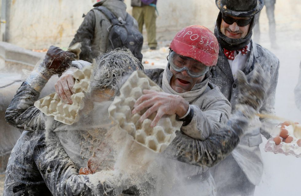 Revellers battle with flour and eggs during the traditional Els Enfarinats (The Floured) festival in Ibi, Alicante Province, Spain December 28, 2016. REUTERS/Heino Kalis