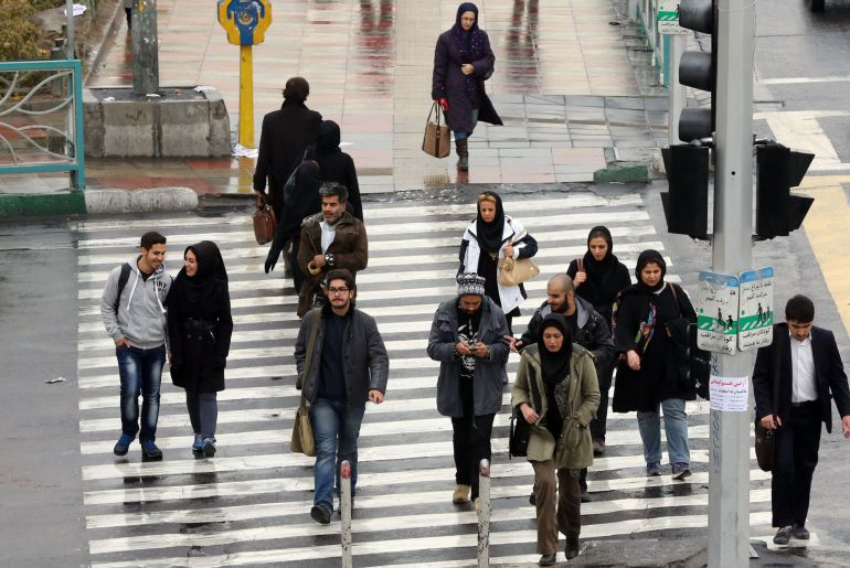 "Iranians walk on a street in the capital Tehran on November 25, 2014. Supreme leader Ayatollah Ali Khamenei said that Iran would not sink ""to its knees"" over its disputed nuclear programme, his first comment since a missed deadline for a deal. Iran and world powers announced on November 24 that talks on a comprehensive nuclear agreement had been inconclusive and would be extended until June 30 next year. AFP PHOTO/ ATTA KENARE"