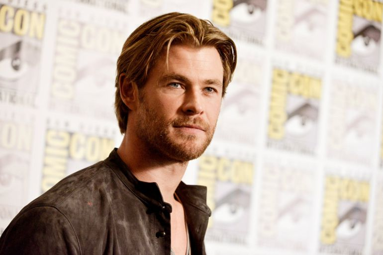 FILE - In this July 26, 2014 file photo, Chris Hemsworth attends the Marvel press line at Comic-Con International in San Diego. People magazine has named Chris Hemsworth the x93Sexiest Man Alivex94 of 2014, cheering the Australian actorx92s rise as hammer-wielding, bone fide hunk in the x93Thorx94 films. (Photo by Richard Shotwell/Invision/AP, File)