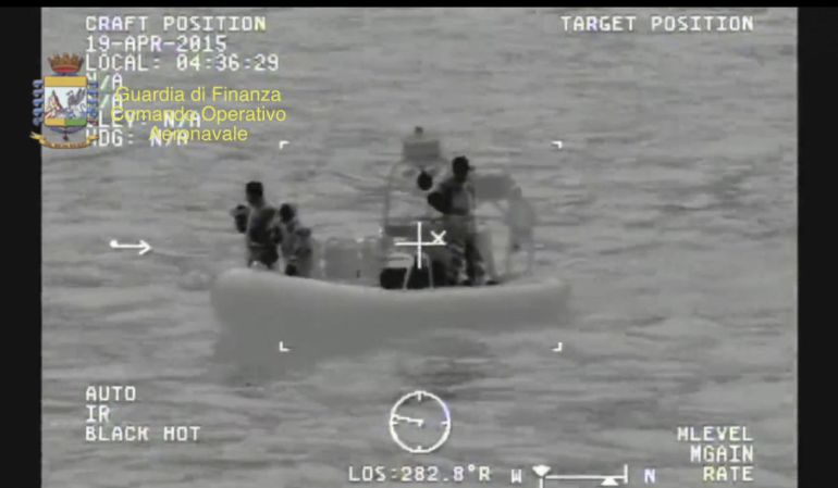 A rescue vessel is seen during the search and rescue operation underway after a boat carrying migrants capsized overnight, with up to 700 feared dead, in this still image taken from video released by Italian Guardia di Finanza April 19, 2015. As many as 700 people were feared dead after the fishing boat packed with migrants capsized off the Libyan coast overnight, in what may be one of the worst disasters of the Mediterranean migrant crisis, officials said on Sunday. Twenty-eight people were rescued and 24 bodies recovered from the 20 metre-long vessel, which sank around 70 miles from the Libyan coast, south of the southern Italian island of Lampedusa, the Italian coast guard said. REUTERS/Guardia di Finanza/Handout via Reuters    ATTENTION EDITORS - THIS PICTURE WAS PROVIDED BY A THIRD PARTY. REUTERS IS UNABLE TO INDEPENDENTLY VERIFY THE AUTHENTICITY, CONTENT, LOCATION OR DATE OF THIS IMAGE. FOR EDITORIAL USE ONLY. NOT FOR SALE FOR MARKETING OR ADVERTISING CAMPAIGNS. THIS PICTURE IS DISTRIBUTED EXACTLY AS RECEIVED BY REUTERS, AS A SERVICE TO CLIENTS.