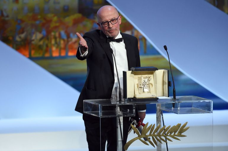 French director Jacques Audiard talks on stage after being awarded with the Palme d'Or during the closing ceremony of the 68th Cannes Film Festival in Cannes, southeastern France, on May 24, 2015.       AFP PHOTO / ANNE-CHRISTINE POUJOULAT