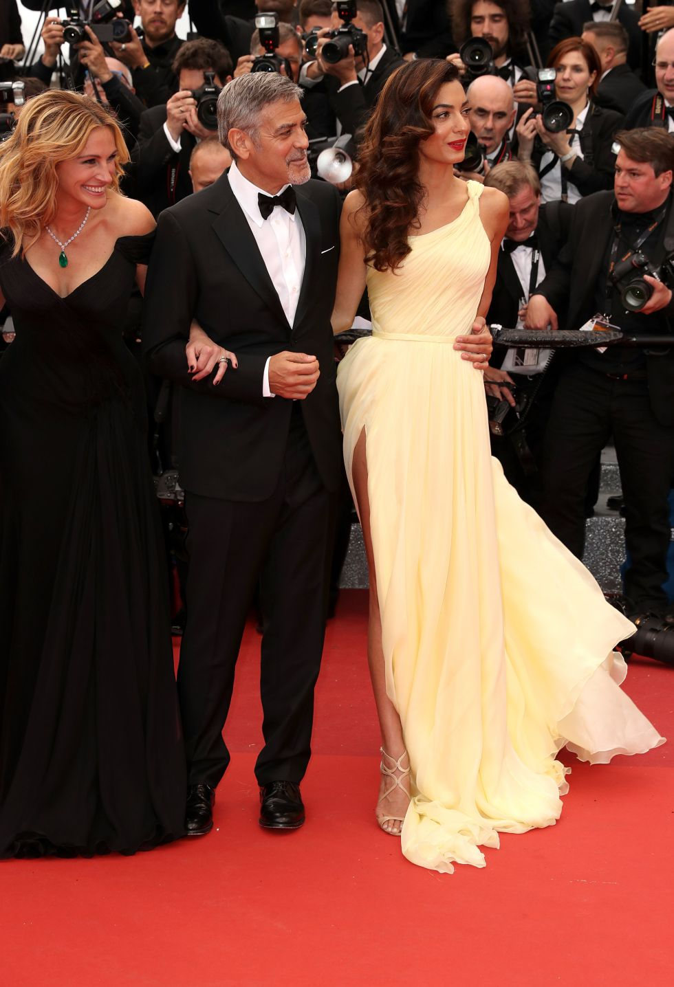 """CANNES, FRANCE - MAY 12: George Clooney and Amal Clooney attend the screening of """"Money Monster"""" at the annual 69th Cannes Film Festival at Palais des Festivals on May 12, 2016 in Cannes, France. (Photo by Luca Teuchmann/WireImage)"""