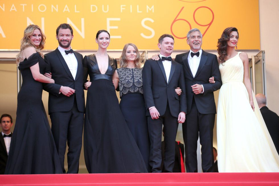 """CANNES, FRANCE - MAY 12: Actors Julia Roberts, Dominic West, Caitriona Balfe, producer Jodie Foster, actors Jack O'Connell, George Clooney and his wife Amal Clooney attend the """"Money Monster"""" premiere during the 69th annual Cannes Film Festival at the Palais des Festivals on May 12, 2016 in Cannes, France. (Photo by Gisela Schober/Getty Images)"""