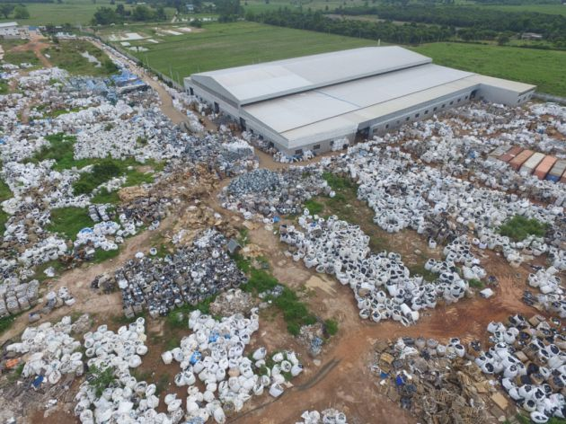 Drone shot of Wai Mei Dat grounds, sprawl- ing with imported WEEE in Super Sacks. Thailand Portal. May 22, 2018