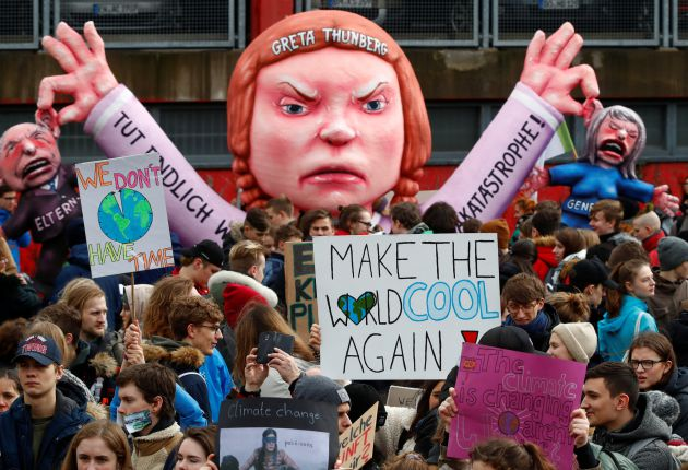 Students use a carnival float depicting Swedish environmental campaigner Greta Thunberg during a strike from school to demand action on climate change at the town hall square of Duesseldorf, Germany, March 15, 2019