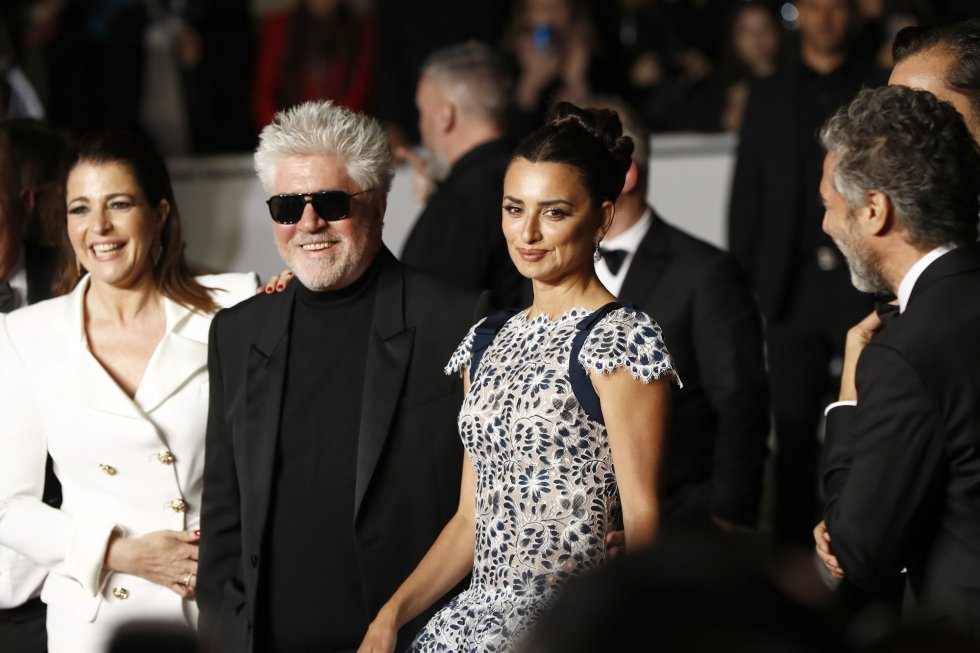 "CANNES, FRANCE - MAY 17: (L-R) Nora Navas, Director Pedro Almodovar and Penelope Cruz, wearing Atelier Swarovski Fine Jewelry, depart the screening of ""Pain And Glory (Dolor Y Gloria/Douleur Et Gloire)"" during the 72nd annual Cannes Film Festival on May 17, 2019 in Cannes, France. (Photo by John Phillips/Getty Images)"