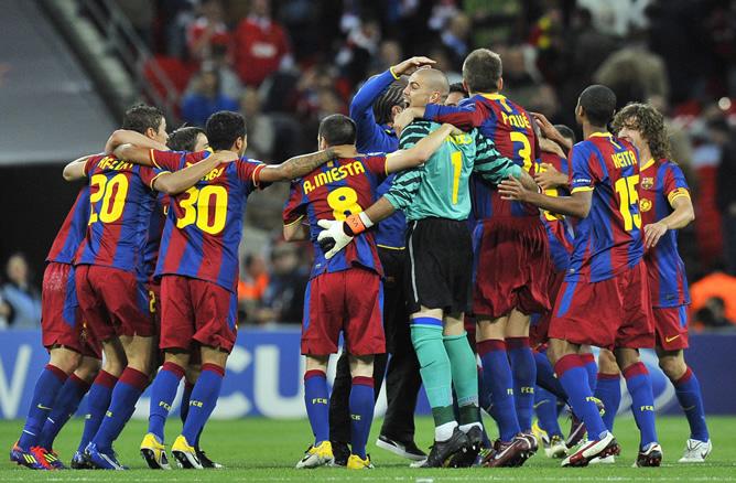 Los jugadores del FC Barcelona celebran hoy, sábado 28 de mayo de 2011, tras el término de la final de la Liga de Campeones de la UEFA contra el Manchester United en el estadio de Wembley en Londres (Reino Unido). El FC Barcelona ganó 3-1 y se coronó como nuevo campeón de Europa.