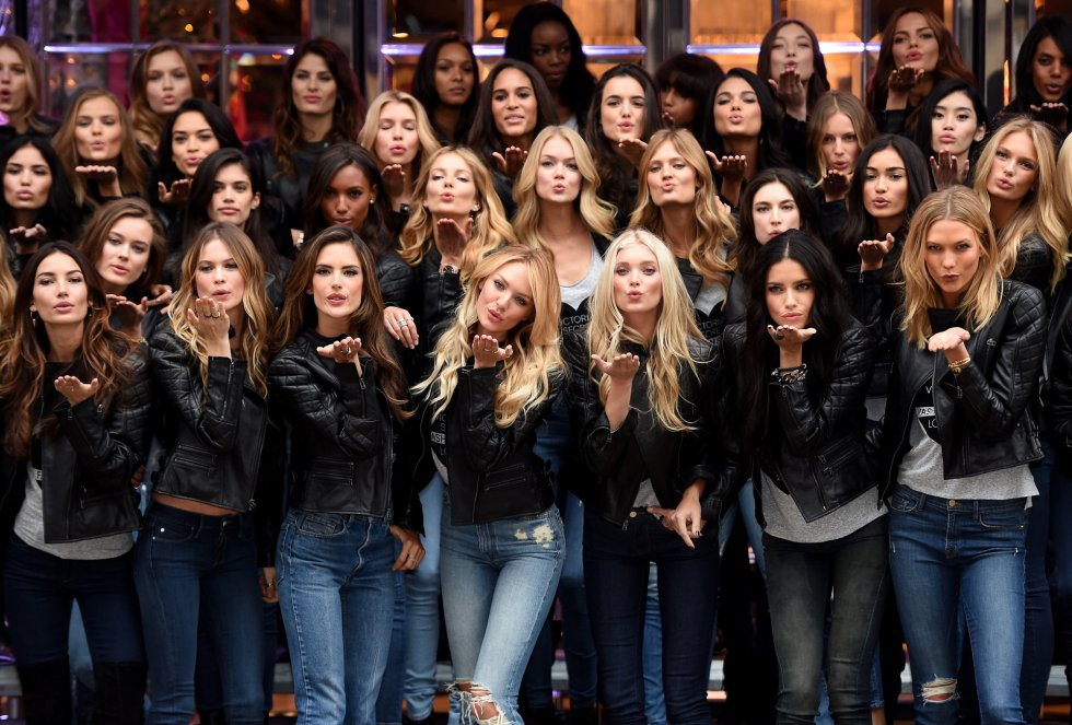 LONDON, ENGLAND - DECEMBER 01:  (Front row L-R) Victoria's Secret Models Lily Aldridge, Behati Prinsloo, Alessandra Ambrosio, Candice Swanepoel, Elsa Hosk, Adriana Lima and Karlie Kloss attend the 2014 Victoria's Secret Fashion Show - Bond Street Media Event on December 1, 2014 in London, United Kingdom.  (Photo by Dimitrios Kambouris/Getty Images for Victoria's Secret)