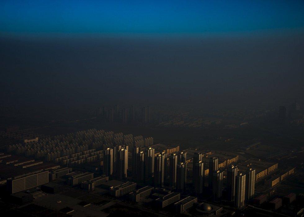 Primer premio en la categoría 'Temas contemporáneos'. Zhang Lei (Haze en China) fotografió la ciudad Tianjin envuelta en bruma.