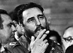 Then Cuban Prime Minister Fidel Castro smokes a cigar during interviews with the press during a visit of U.S. Senator Charles McGovern, in Havana in this May 1975 file photo. REUTERS/Prensa Latina/File Photo