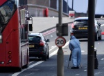 A police forensics investigator works amongst abandoned buses and cars on London Bridge after an attack left 7 people dead and dozens injured in London, Britain, June 4, 2017. REUTERS/Dylan Martinez