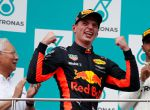 Formula One F1 - Malaysia Grand Prix - Sepang, Malaysia - October 1, 2017. Redbull's Max Verstappen celebrates winning the race between Malaysian Prime Minister Najib Razak and Mercedes' Lewis Hamilton. REUTERS/Edgar Su