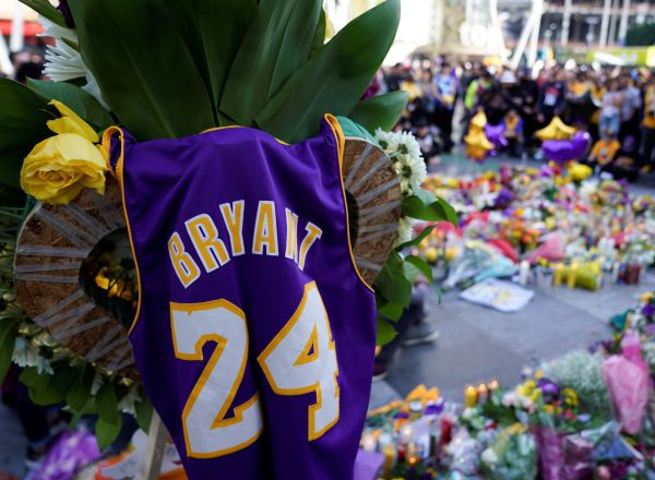 Fans of NBA basketball star Kobe Bryant pay their respects at a memorial outside the Staples Center at L.A. Live in Los Angeles, California, U.S., January 27, 2020. REUTERS/Mike Blake