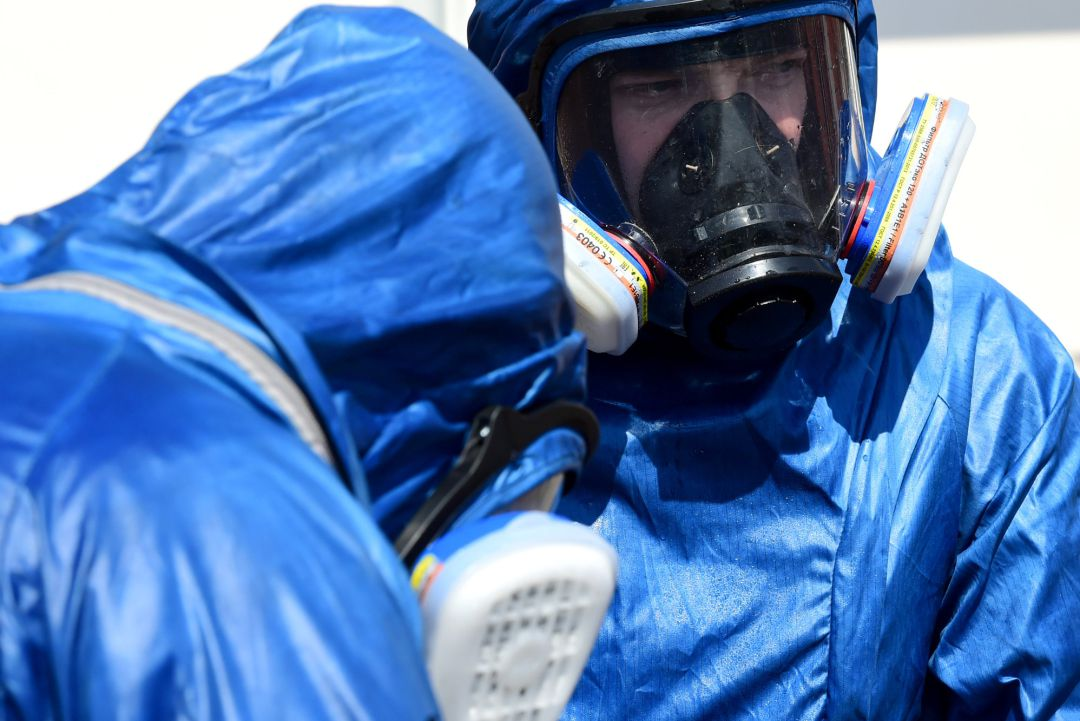 Two Russian soldiers prepare to sanitize the exterior of the Carlo Giovanni Rota retirement home for the elderly in Almenno San Salvatore on April 2, 2020 in Bergamo, Italy. The government of the Russian Federation has sent medical equipment, mobile laboratories and disinfection units, doctors and even military experts in a bacteriological warfare to help the Italian military in the areas most affected by the coronavirus outbreak. The Italian government continues to enforce the nationwide lockdown measures to control the spread of COVID-19.