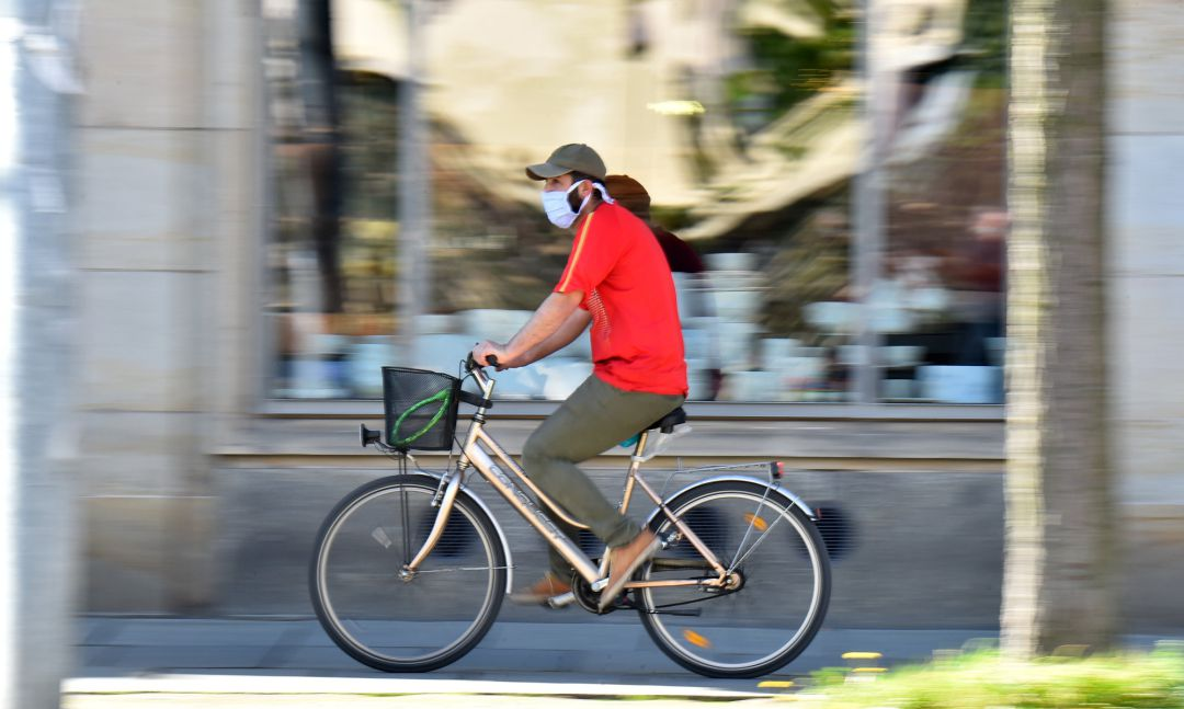 A man on a bicycle is wearing a protective mask, as the spread of the coronavirus disease (COVID-19) continues in Dresden, Germany, April 20, 2020