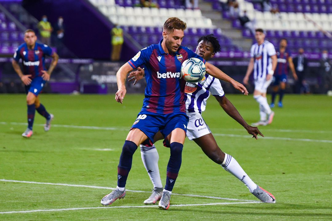 Ruben Rochina of Levante UD is tackled by Mohammed Salisu of Real Valladolid