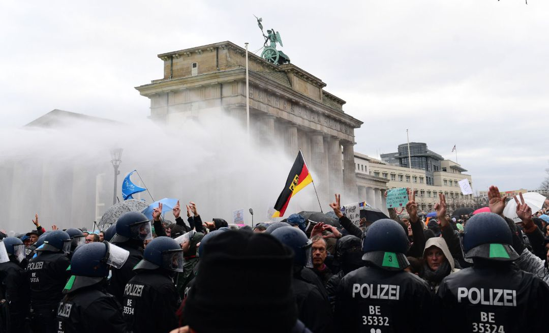 Riot police uses water cannons to break up a demonstration against German coronavirus restrictions