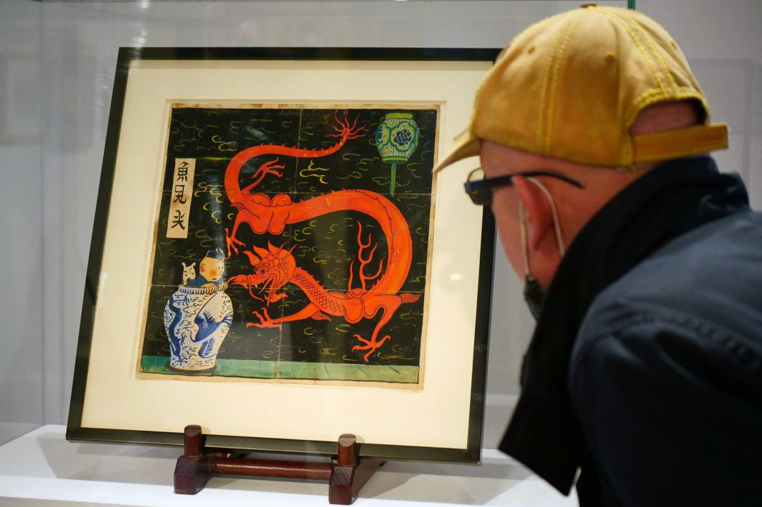 "Painting for the original cover of ""The Blue Lotus"" (Lotus Bleu) Tintin comic book (1936), is displayed before being auctioned by Artcurial in Paris, France January 13, 2021"
